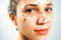 Cara con las líneas para la cirugía plástica Fotos de archivo libres de regalías
