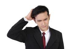 Cara confusa del hombre de negocios, aislada en blanco Imágenes de archivo libres de regalías
