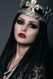 Cara da bruxa na coroa de prata com joias Foto de Stock Royalty Free