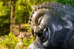 A cara da Buda é preta imagens de stock royalty free