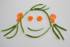 Cara da menina formada fora dos vegetais Imagem de Stock Royalty Free