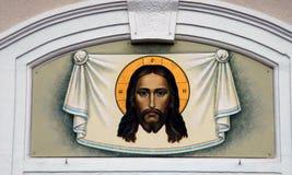 Cara de Jesus ChristPainting em uma parede Foto de Stock Royalty Free