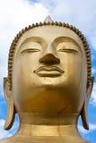 Cara de la estatua de Buddha del oro Foto de archivo libre de regalías