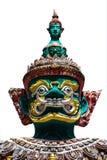 Cara de la estatua tailandesa gigante del estilo en el fondo blanco Imágenes de archivo libres de regalías