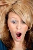 Cara de la maravilla de la mujer con la boca abierta Foto de archivo libre de regalías