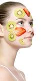 Cara de la muchacha con la máscara de la fruta Imágenes de archivo libres de regalías