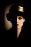 Cara de la mujer con mitad negra imagen de archivo
