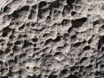 Cara de la piedra caliza de Pocked Foto de archivo libre de regalías
