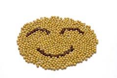 Cara de la sonrisa hecha de sojas y de onobrychis Imagen de archivo