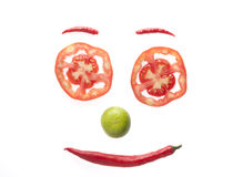 Cara de la sonrisa por el tomate, el chile, y el limón Imagenes de archivo