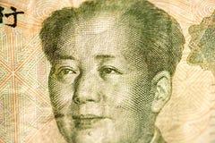 Cara de Mao, líder de China em uma cédula do chinês Yuan, como um símbolo da economia moderna Fotografia de Stock Royalty Free