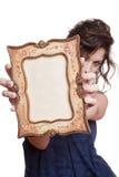 Cara de ocultación de la mujer con un marco Fotografía de archivo