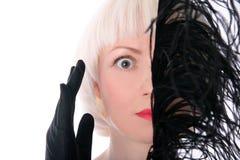Cara de ocultación de la mujer encantadora Fotografía de archivo libre de regalías