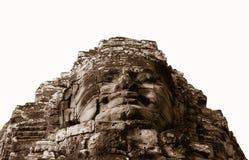 Cara de pedra no templo antigo de Bayon, Angkor em Camboja Imagem de Stock