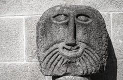 Cara de piedra antigua de la escultura, Braga foto de archivo libre de regalías