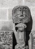 Cara de piedra antigua de la escultura, Braga imagenes de archivo