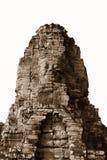 Cara de piedra en el templo antiguo de Bayon, Angkor en Camboya Foto de archivo libre de regalías