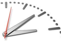Cara de reloj simple con la opinión de la diagonal de las manos y de las marcas del metal Fotos de archivo libres de regalías
