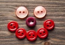 Cara de sorriso feita do close-up colorido dos botões Foto de Stock Royalty Free