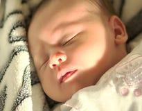 Cara de um bebê de sono Foto de Stock