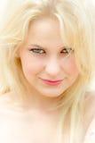 Cara de uma jovem mulher bonita imagem de stock