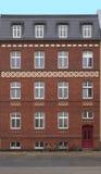 Cara de una casa roja de Bricked Fotos de archivo libres de regalías
