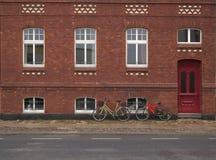 Cara de una casa roja de Bricked Foto de archivo