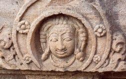 Cara de uno de dioses hindúes del templo, la India Ejemplo de la arquitectura india en Pattadakal, sitio del patrimonio mundial d Foto de archivo