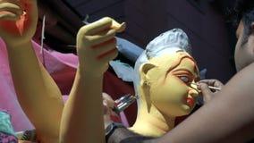 Cara del ídolo de la arcilla de la diosa Durga almacen de video
