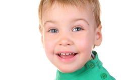 Cara del bebé de la sonrisa fotos de archivo