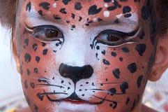 Cara del cabrito de la muchacha con la máscara 4 de la pantera Imágenes de archivo libres de regalías