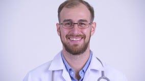 Cara del doctor barbudo feliz del hombre que cabecea la cabeza sí almacen de video