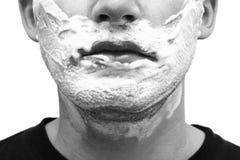 Cara del hombre con crema de afeitar Imagenes de archivo