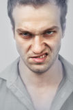 Cara del hombre enojado malvado fotografía de archivo