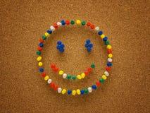 Cara del smiley de la chincheta Imágenes de archivo libres de regalías