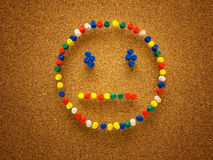 Cara del smiley de la chincheta Imagen de archivo libre de regalías