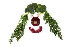 Cara divertida con la variedad de verduras Fotos de archivo
