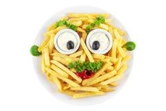 Cara divertida de las patatas fritas Fotografía de archivo libre de regalías