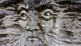 A cara do ancião na pedra Fotos de Stock Royalty Free