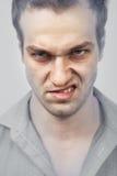 Cara do homem irritado mau fotografia de stock