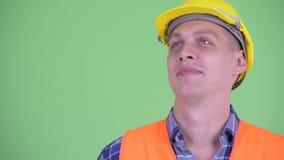 Cara do pensamento feliz do trabalhador da construção do homem novo filme