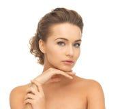 Cara e mãos da mulher bonita Foto de Stock Royalty Free