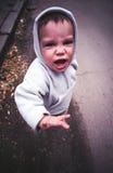 Cara enojada del niño Foto de archivo
