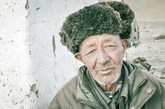 Cara enrugada em Tajiquistão Fotos de Stock