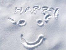 Cara feliz de tiragem do smiley na neve no fundo do tempo de inverno, símbolo Imagens de Stock Royalty Free