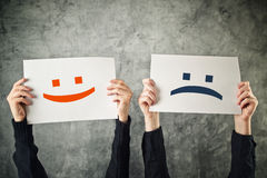 Cara feliz e triste. Foto de Stock