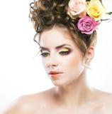 Cara femenina hermosa con el lunar y la flor Fotos de archivo libres de regalías