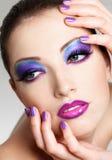 Cara femenina hermosa con maquillaje de la manera Fotos de archivo libres de regalías