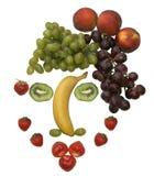 Cara hecha fuera de diversas frutas Foto de archivo