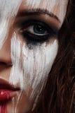 Cara hermosa con la pintura manchada blanco imágenes de archivo libres de regalías